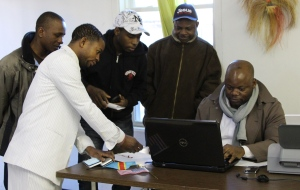 CCNH Secretary Victor Mbuyi registers members to vote.