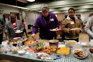 Attendees help themselves to the potluck dinner.